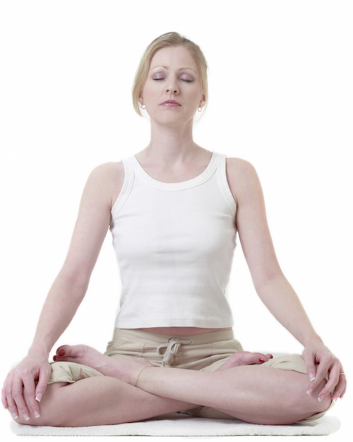 Life coach meditating in lotus position
