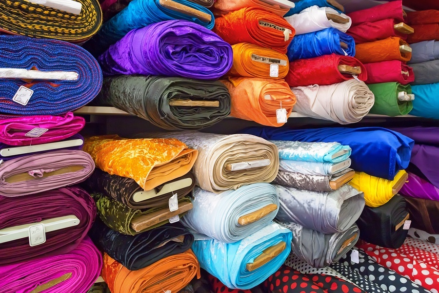 Rolls of textile cloth and tissue of various colours on the market