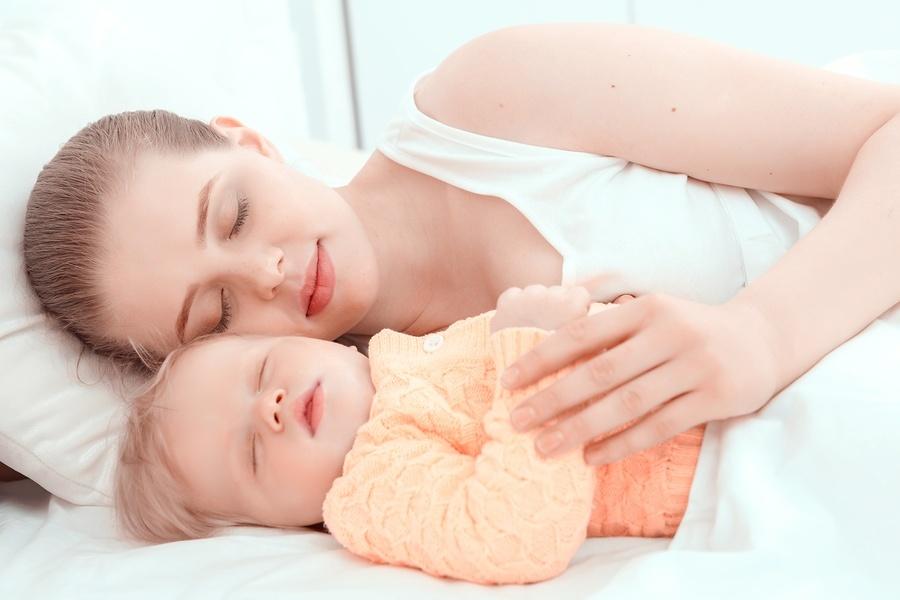 sleeping mum and child